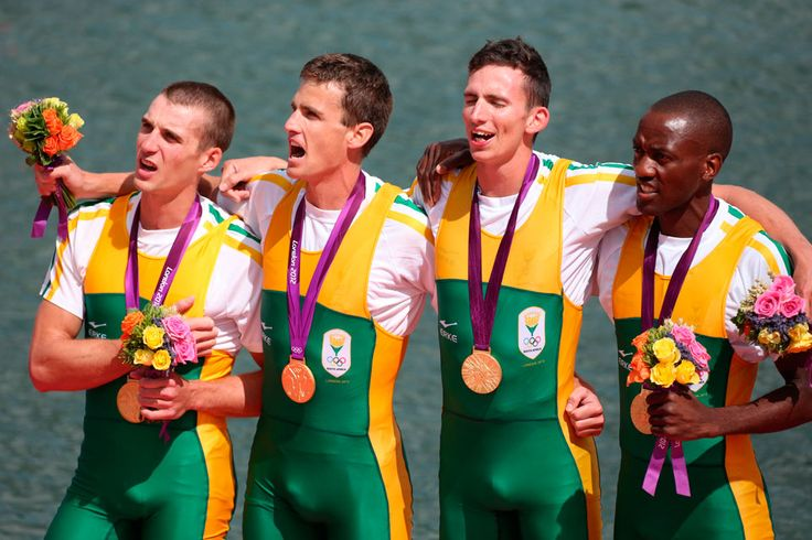outh Africa wins the men's lightweight four rowing event and teammates (L to R) James Thompson, Mathew Brittain, John Smith, and Sizwe Mdlovu enjoy signing their national anthem.