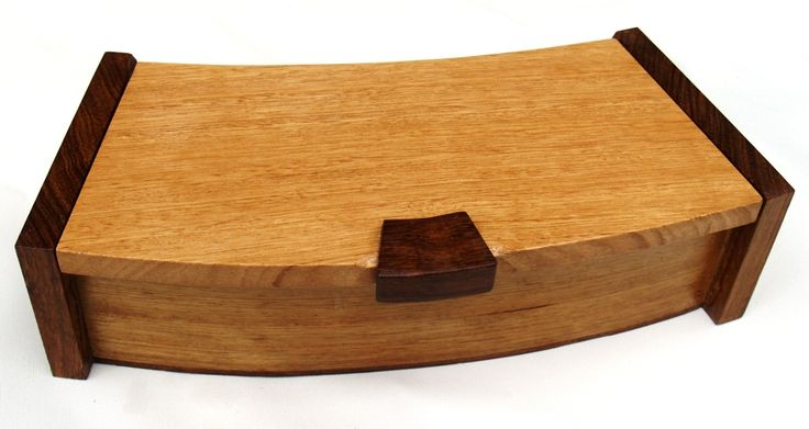 "Curved Box No.1 by Frank Duyker was made from old pieces of Victorian Ash from a discarded circular dining table. The ends and handles are from a salvaged wood, probably ""wenge""."