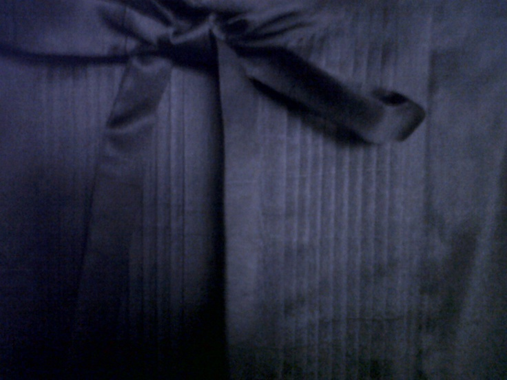 70s black taffeta chemisette with pleating on front and small buttons on back. Nice bow closure on the neck
