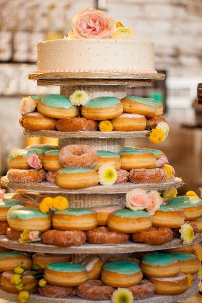 16 Delicious Wedding Donut Display Ideas: Colorful and fun wedding cake + donut tower! Follow @weddingwire for more wedding cake ideas. {Ashlyn Dawson Photography}