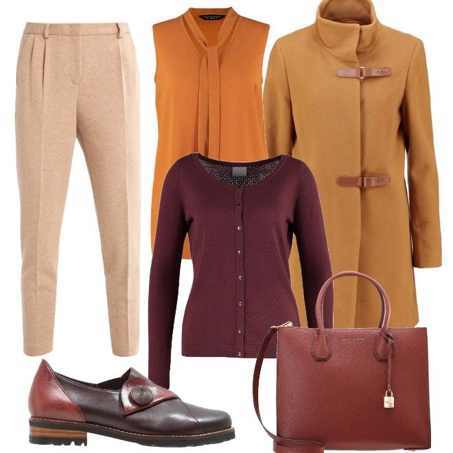 Cappotto in lana con chiusure a cintura, pantalone in morbido beige e camicia con dettaglio al colletto. Cardigan leggero color chocolat che richiama la borsa a mano o a tracolla. Scarpa bassa in pelle molto piena di dettagli e dai colori autunnali.