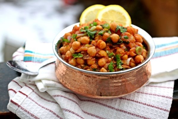 An easy variation of curried chickpeas done in a slow cooker, essentially a super simple slow cooker channa masala.