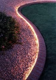 Rope lighting around a garden path makes for a beautiful landscape.