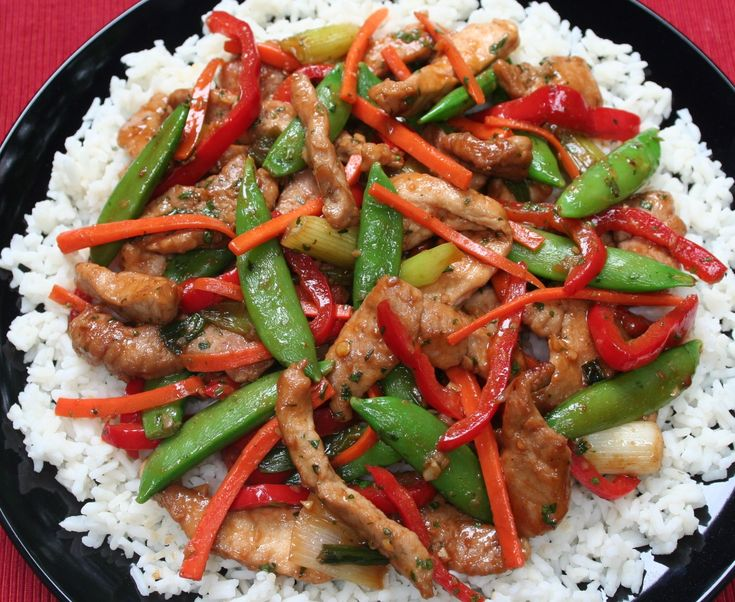 Satisfy your hunger in less than 30 minutes with Pork Stir-Fry with Peppers, Carrots, and Sugar Snaps on a bed of white or brown rice. Click on the image for the recipe.