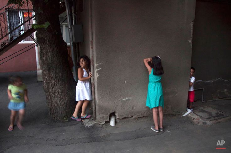 In this Saturday, July 11, 2015 photo, children play hide and seek in Tbilisi, Georgia. (AP Photo/Tinatin Kiguradze)