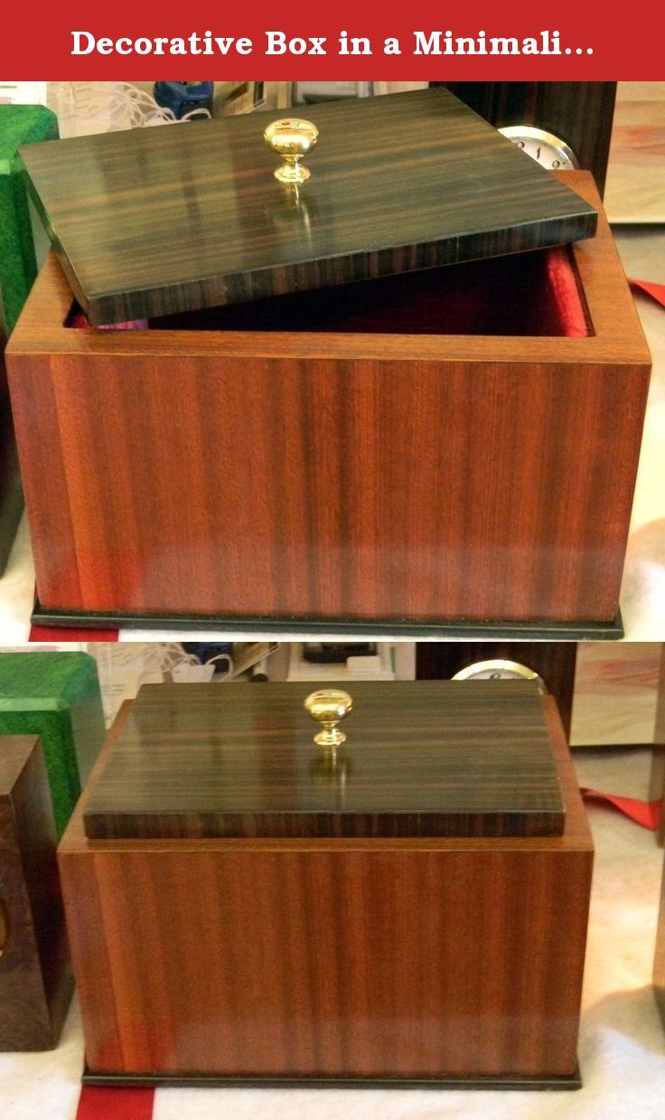 Decorative Box in a Minimalist Modern Style. Sepele wood base and macasser ebony top. Brass knob and red velvet interior.