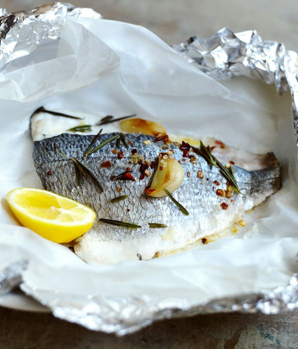 Sea bream is delicious and wonderfully tender when cooked en papillote and roasting garlic brings a creamy sweetness to the dish.