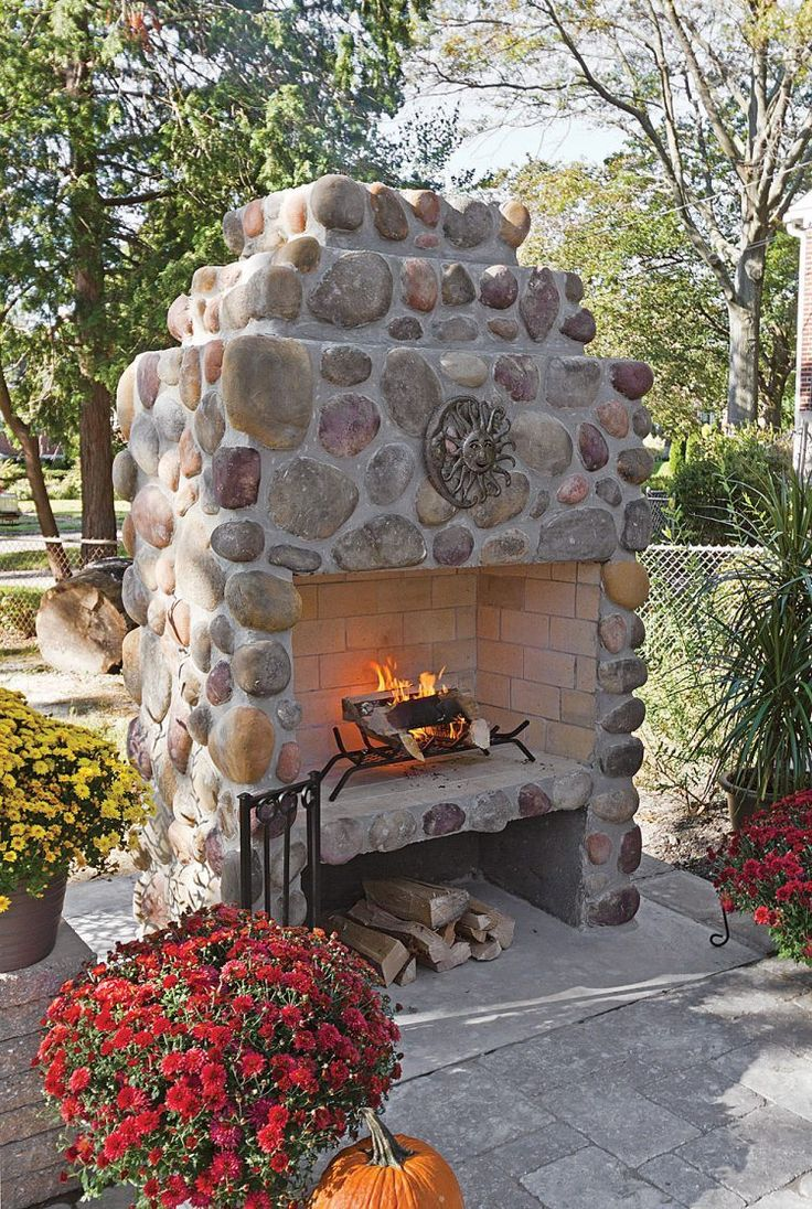contemporary outdoor stone fireplace