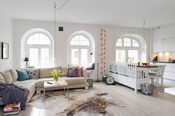 Interior:Comfortable Scandinavian Interior Design Living Room With Sofa Cushions And Table On Animal Skin Rugs And Laminate Wood Flooring With Coffee Table And Cabinets Then Flooring Standing Lamps And Table Lamps Living Room? Think about the Scandinavian Interior Design Living Room