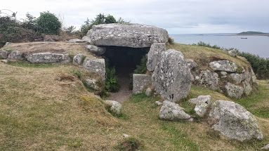 Bant's Carn, entrance grave, Halangy Village, Isles of Scilly, up the hill from the main village area. In the background, Samson island