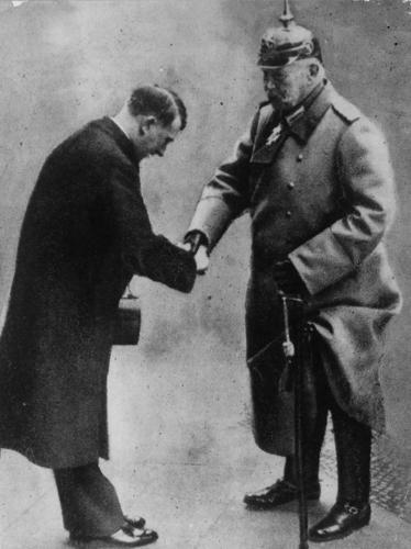 30th January 1933: Soldier and statesman President Paul von Beneckendorff und von Hindenburg (1847 - 1934) handing over the rule of Germany to the Nazi leader Adolf Hitler.
