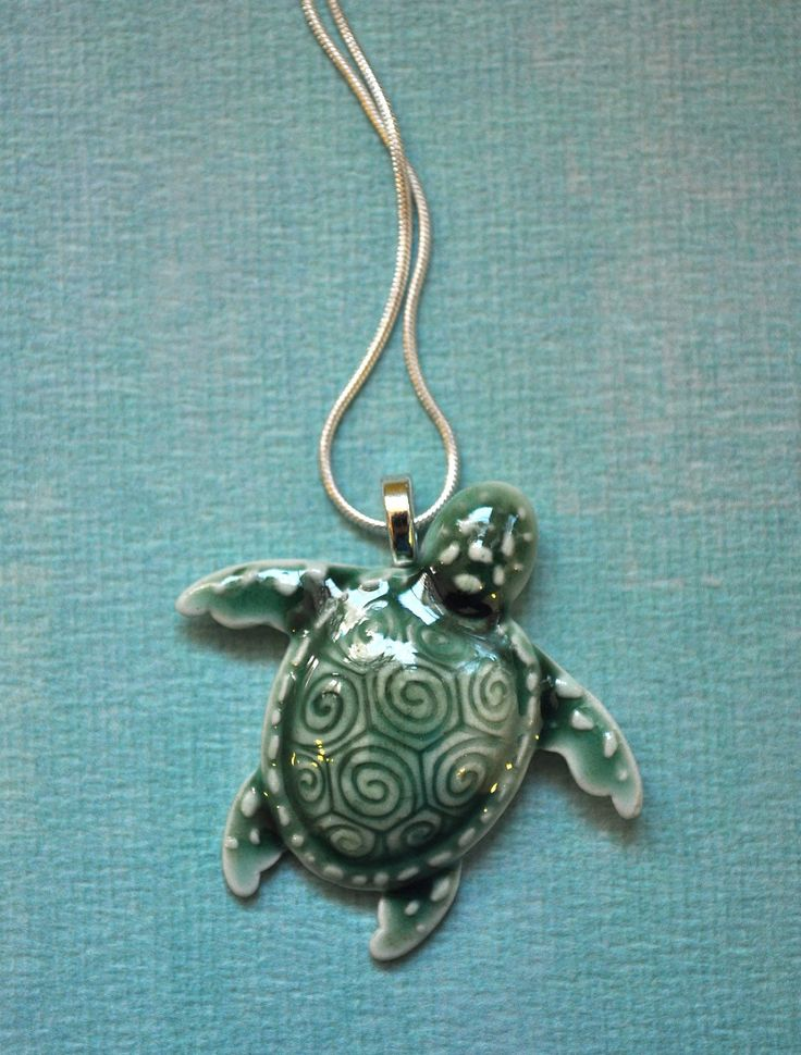 Porcelain Sea Turtle Necklace in deep green on sterling silver chain. via Etsy.