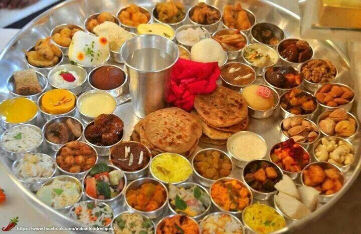 Gujarati Thali available at restaurant in Surat. It's veg comes with seven types of salad, 55 types of vegetables, 12 types of sweets, 15 types of rotis in addition to accessories like buttermilk, water, etc. Cost of Thali is 1500