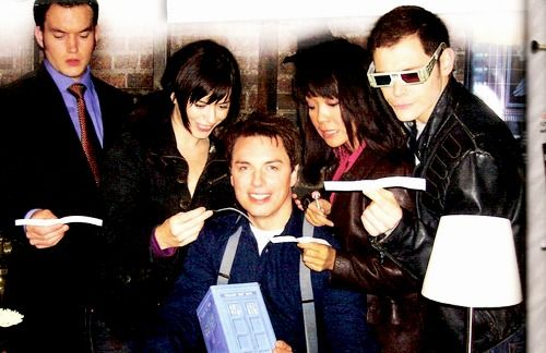 I have no idea what's going on...but Owen is wearing 3-D glasses and Jack is holding a baby TARDIS. Torchwood, what are you doing?! :P