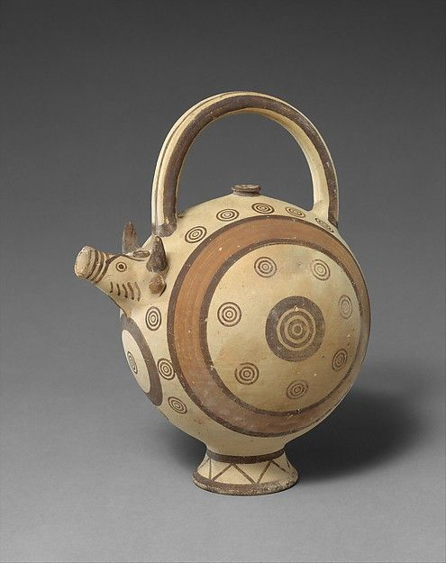 Cypriot Terracotta Trick Vase, Cypro-Archaic I, 750-600 BCThe vase is in the form of a bull. It was filled through the hollow foot and emptied through the hole in the bull's mouth, which is a spout modified into a head. Trick vases of this kind first appear in Cypro-Geometric pottery.