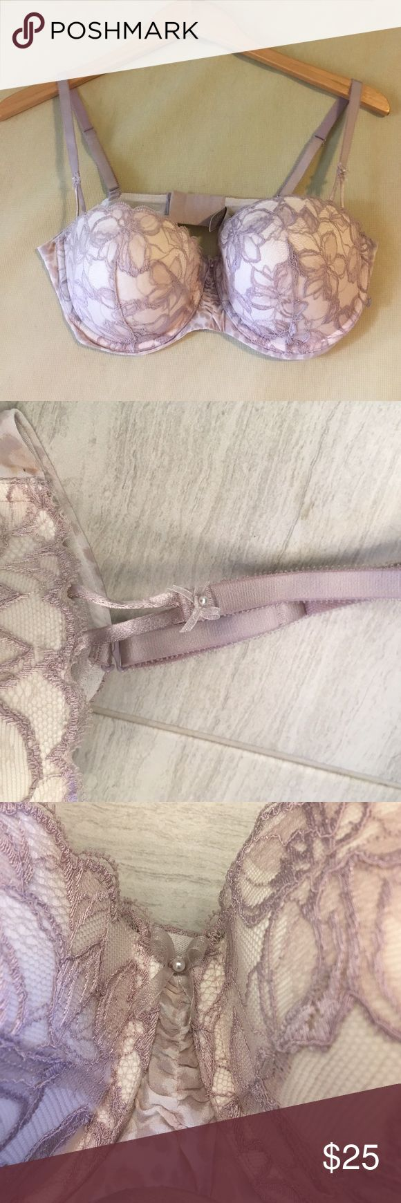 NWOT Victoria's Secret Balconet bra NWOT never worn Size 36 D Victoria's Secret Balconet lightly padded push up bra. Lace design in cups leading to smooth printed fabric on band, lace again just before the clasp. There's also cute pearl detailing at the center of the bra and on the straps. Victoria's Secret Intimates & Sleepwear Bras