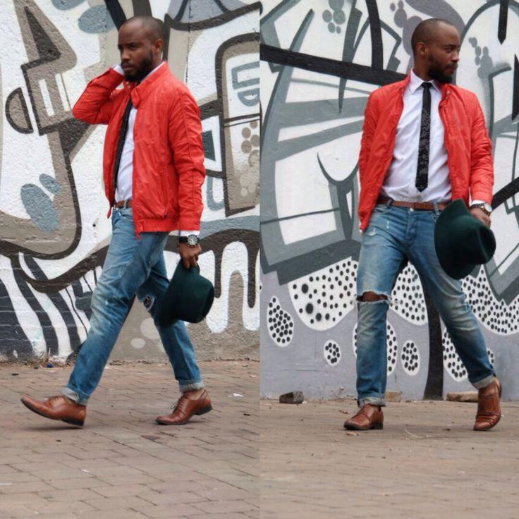 Tangerine windbreaker: Celio* White shirt: Studio W Black tie: Ephymol Jeans: Diesel Shoes: Aldo Fedora: HOT