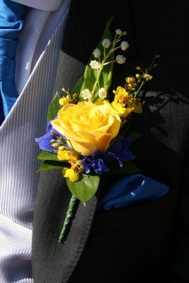 Lily of the Valley, Lemon Oncidium Orchid, Blue Delphinium heads and an Illios Rose