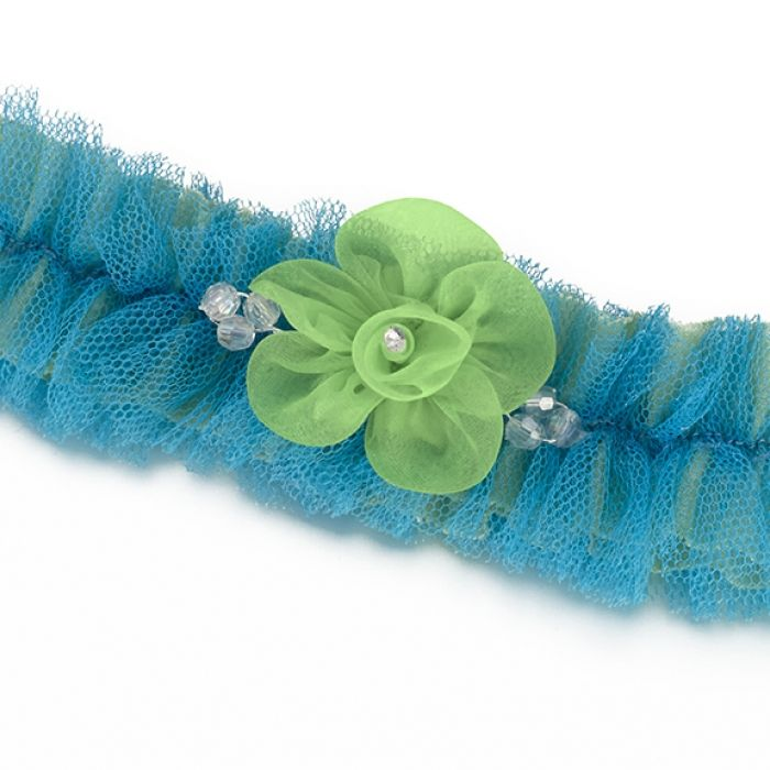 A blue tulle mesh combined with green underlay make up this stunning leg garter. Attached to the center is a green mesh flower decorated with crystal ornament.