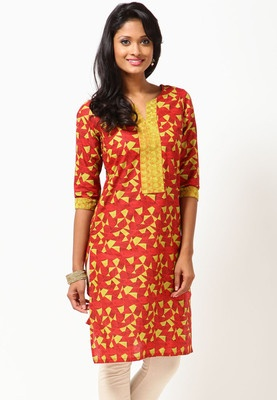 A red coloured, printed kurta for women from Folklore. It is made from 100% cotton and comes in a regular fit. It has knee length, half sleeves and a round neck.  In Just Rs. 949