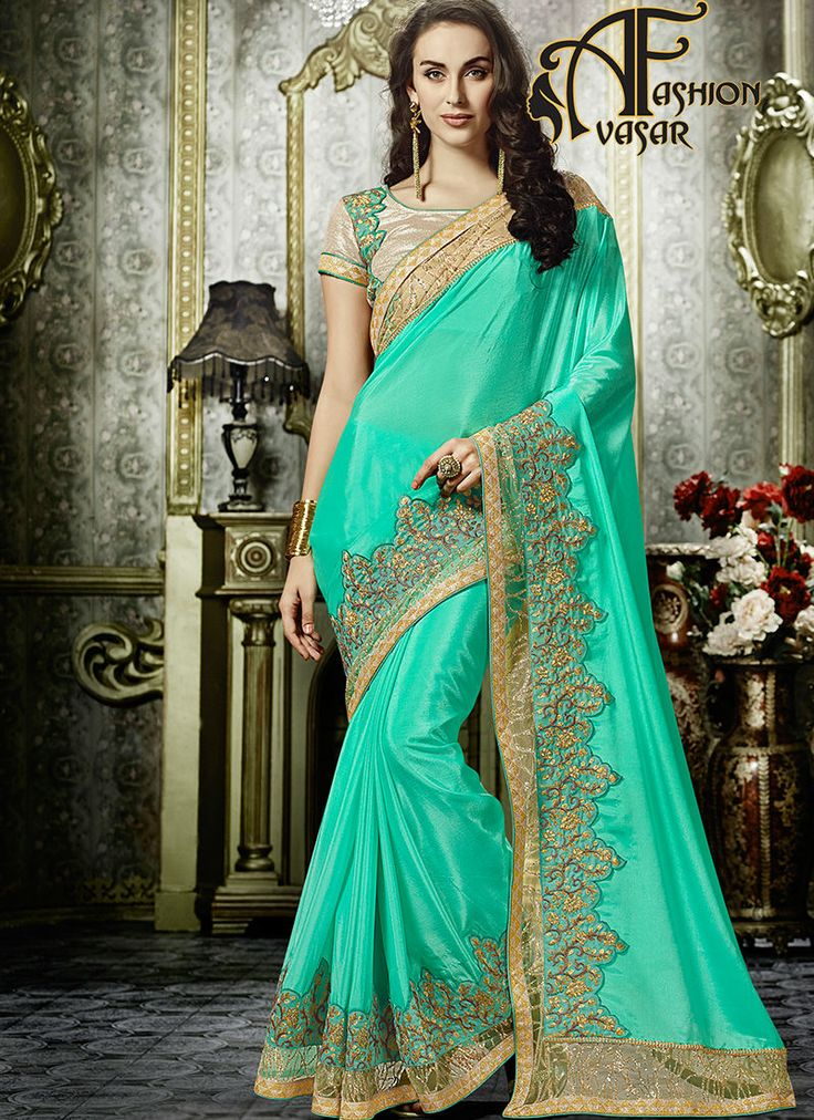 Turquoise Chiffon Saree.True attractiveness can come out from your dressing design with this Turquoise Chiffon Saree. The ethnic Zari Work & Stones work at
