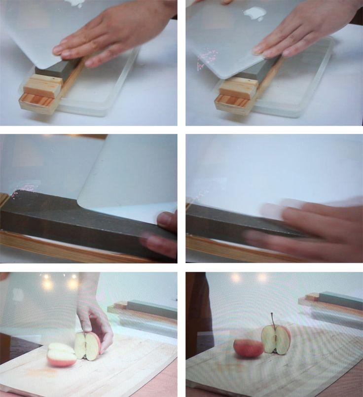 shimabuku's sharpened macbook air cuts an apple at the venice art biennale