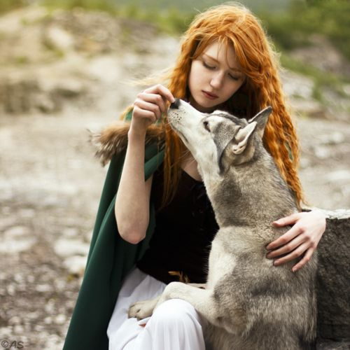 A young lady with a special connection with animals. Maybe she grew up with them in the wild.
