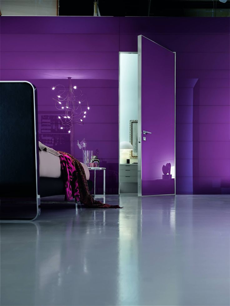 Project safety door for interiors in purple lacquered glass.
