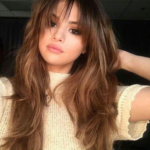 Selena gomez, layers, fringe bangs, round face, hair cut, hair style.