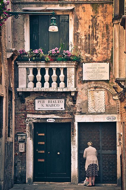 I have been in this exact spot in Venice, and the old woman in the picture acutally waved at us!