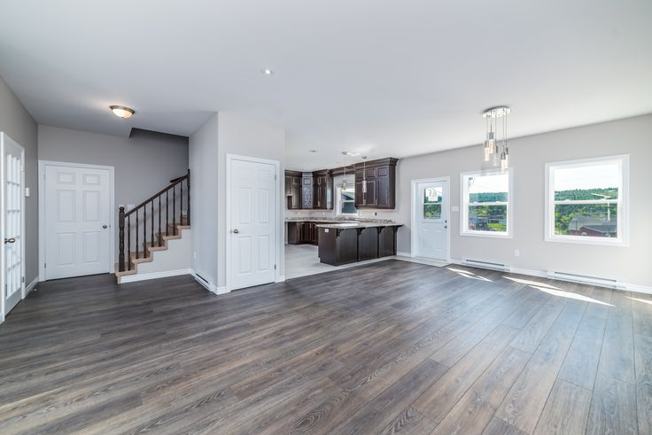 The large open concept living room and dining room off the kitchen of this Augusta design!