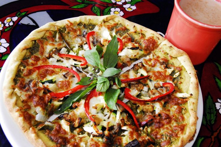Annapurna's Build Your Own Gourmet Pizza A rustic hand rolled thin herbed crust sits under a perfectly seasoned traditional marinara or pesto baked into a bountiful variety of your choice of five of the following toppings:  mozzarella, cheddar, feta, mushrooms, tomatoes, artichoke hearts, roasted red peppers, veggie bacon, onions, spinach, grilled eggplant, zucchini, olives and green chili. #annapurna #albuquerque #santafe #newmexico #pizza #ayurveda