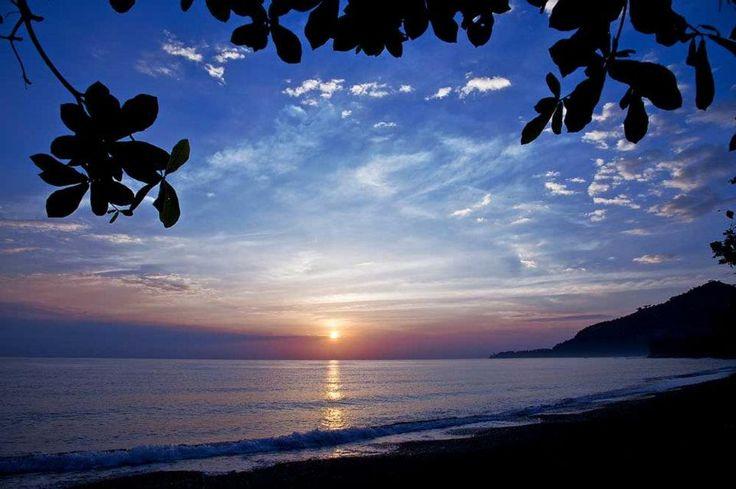 The sun is setting in the bay of pemuteran nw#Bali