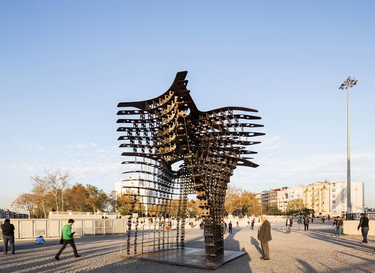 """GAD Architecture has installed their latest sculptural design, Serra Gate, in Istanbul's Taksim Square, just in time for Istanbul Design Week. Named after the minimalist sculptor whose work inspired the design, the Serra gate's steel form was created using cutting edge technology. The sinuous curvature was conceived through the software """"Mathematica,"""" and was modeled using the latest 3D printing technologies."""