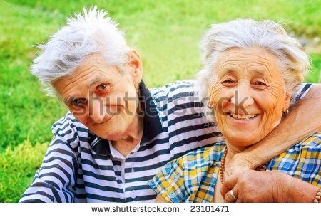 Outdoor portrait of two seniors in love - stock photo