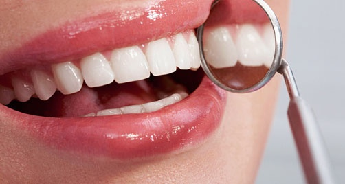 Tooth hypersensitivity occurs when the dentin, which lies just below the surface of the tooth, becomes exposed; causing tubulestiny structures that transmit stimuli to the tooth nerveto open up. When open tubules come in contact with cold, hot, sweet, or acidic substances, painful stimuli are transmitted to the tooth nerve.   Typically, hypersensitivity is caused by oral bacteria, which attach to the tooth surface and leave an acidic residue of tartar and plaque.