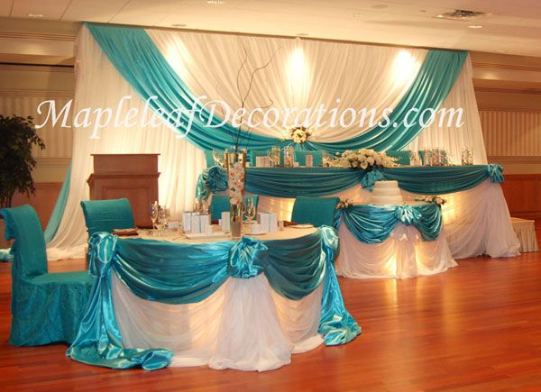 Toronto Wedding Decorations - Custom Backdrop and Head Table Draping Design by Mapleleaf Decorations in Tiffany BLue or Turquoise Blue Satinand White Sheer fabrics at The West River BAnquet Hall (Woodbridge). Contact us for more info www.MapleleafDecorations.com