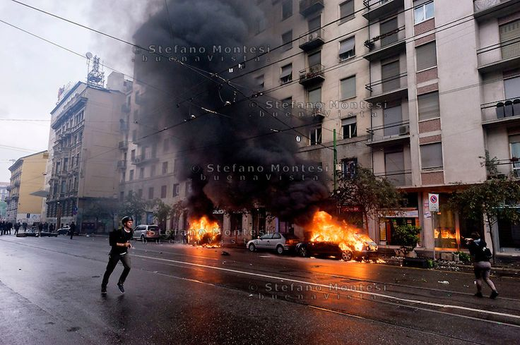 Milan, May 1, 2015 Mayday NoExpo Clashes protesters against police during the demonstration in downtown Milan, to protest against Universal Exposition Milano 2015. Cars set on fire by protesters