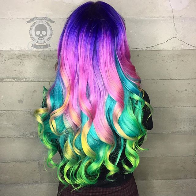 Breathtaking color melt by Rickey Zito; ribbons of curls by Jenny Strebe color melt rainbow hair unicorn hair mermaid hair hotonbeauty.com