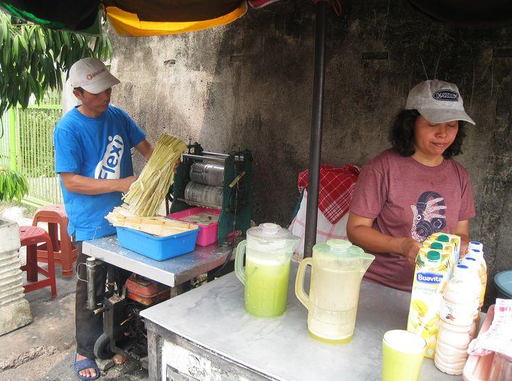 Es air tebu (sugarcane juice) seller at street side of Jalan Percetakan Negara, Central Jakarta, Indonesia.