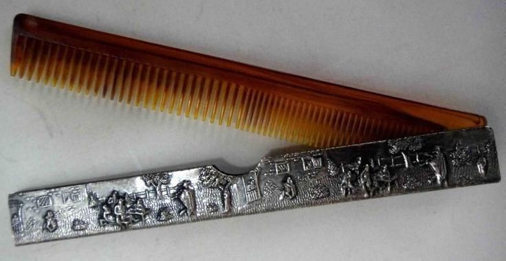 https://www.ebay.com/itm/vintage-LADIES-FAUX-TORTOISE-HAIR-COMB-ornate-silver-cv/232680408564?hash=item362cd545f4:g:SMoAAOSwOzNalMZg