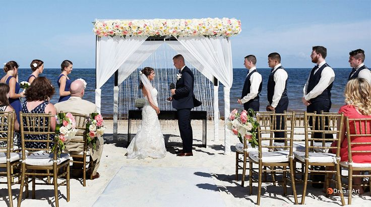 Altar covered in roses for beach wedding at Moon Palace Cancun #destinationwedding