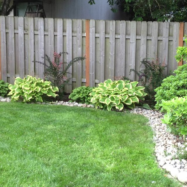 We just added river rock border around the yard