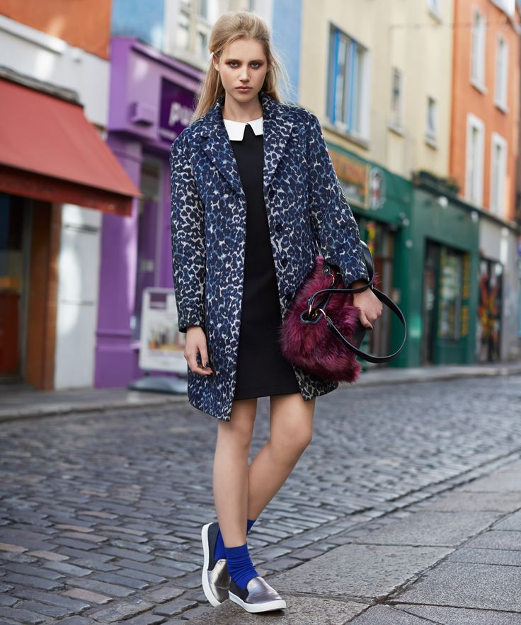 Contrast colour and texture with a faux-fur handbag, fitted black dress and blue leopard print coat, all from Savida by Dunnes Stores
