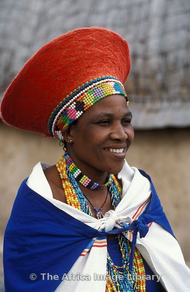 Africa |  Zulu married woman wearing a traditional hat | Kwazulu-Natal, South Africa.