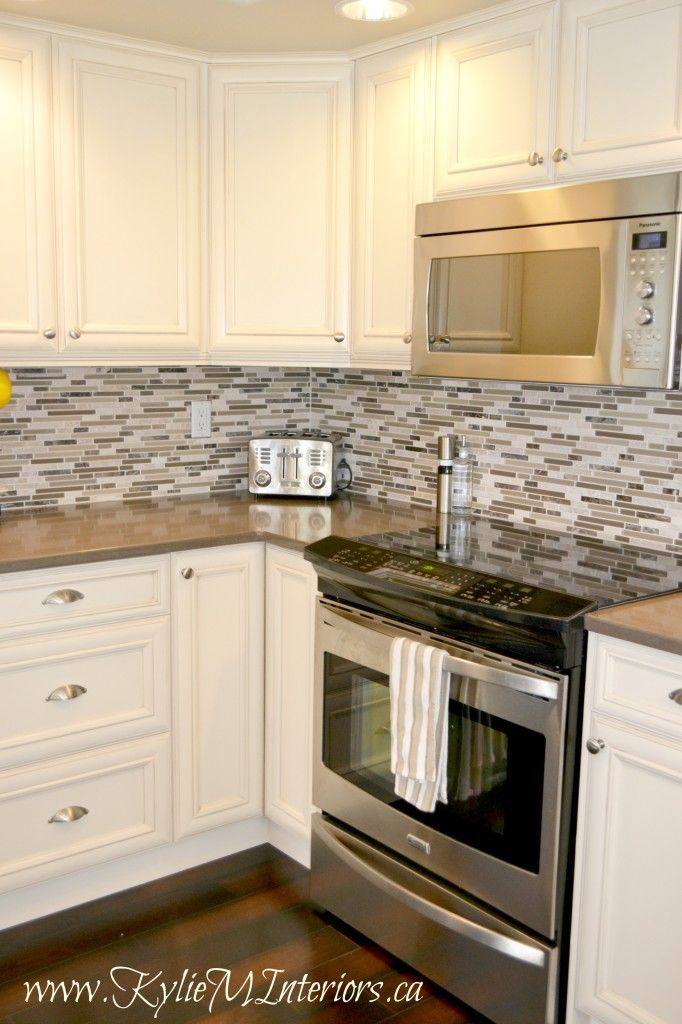Kitchen Remodel Cream Glazed Cabinets With Mosaic Tile Backsplash And Dark Wood Floors