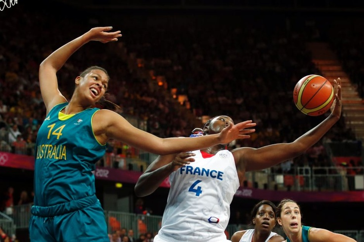 Olympics Day Three - in pictures - Cambage battles against France - France's Isabelle Yacoubou (R) grabs the rebound from Australia's Liz Cambage during the women's preliminary round Group B basketball match at the Basketball Arena during the London 2012 Olympic Games July 30, 2012. Reuters: Sergio Perez