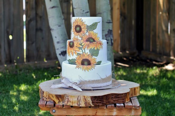 Rustic hand painted sunflower wedding cake with burlap and lace ribbon, by Sweet and Swanky Cakes in Bend, OR