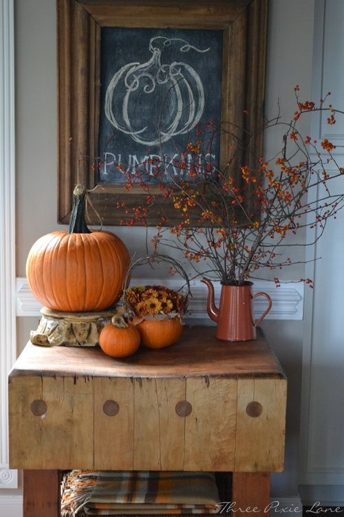 Fall decor - Simple attractive sign and pumpkins. I like the idea of a framed chalk board above an entry table. For every season/holiday it could be family effort to draw a sign or picture to greet your guest according to the time of year.