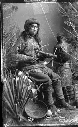 Cha-si-to (the son of Bonito) with a Mescal Fiddle - White Mountain Apache - 1883